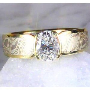 1.50 Carats Mokume Solitaire Ring Oval Diamond